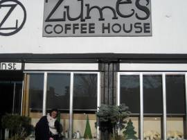 Intern Kendall being forced, by tyrant Devin, to pose in front of Zumes...it was cold